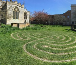 church with labyrinth in the grass - should Christians walk the labyrinth