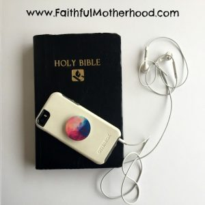 Black Bible with phone and headphones: Teen to Study the Bible