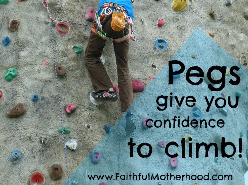 Person climbing on a climbing wall. Text says Pegs give you confidence to climb.