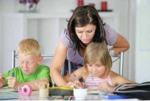 Homeschool mom helping kids with school work