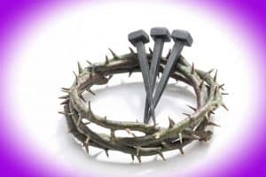 Jesus Christ crown of thorns and nails on a white background.