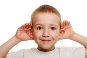 Child cupping ears - child listen to the sermon