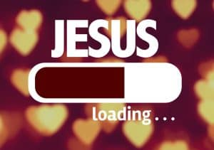 "Computer screen loading ""Jesus"" - an allusion to online church, online worship."