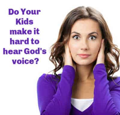 Do Your Kids make it hard to hear God's voice? Mom covering her ears because it is hard to have a quiet time with God when you have loud kids.