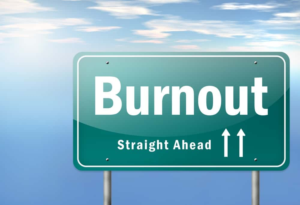 road sign with the word burnout on it, straight ahead double arrows up