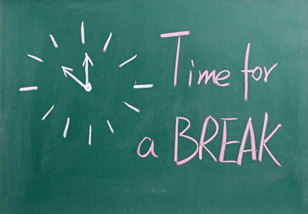Mom ready to quit homeschooling has drawn a clock with the words time for a break.
