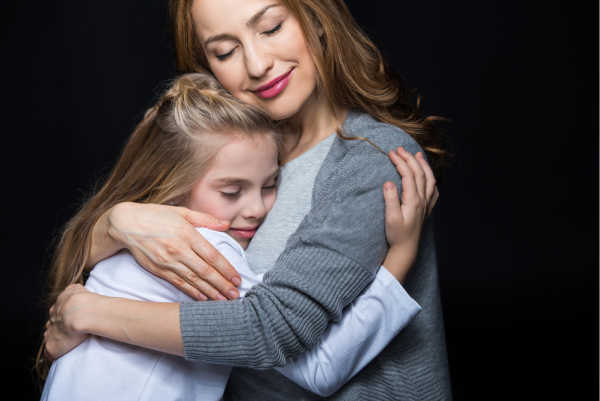 Mom hugging daughter with both smiling - an example of the relationship building needed for discipling