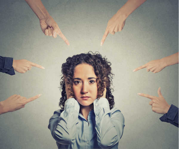 What it looks like when someone questions your call - six different hands with fingers pointed all at one woman.  She looks sad and overwhelmed with her hands over her ears and looking directly at you.