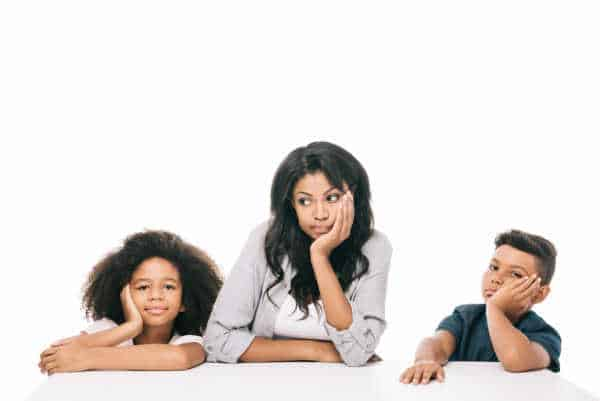 Little girl, Mom, and little boy all with heads in hands and BORED.  African-American mom. All are bored and dislike the children's ministry.