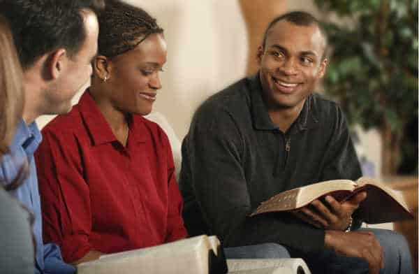 Parents who are engaged in Bible study, even though they dislike the children's ministry - they have their bibles open.