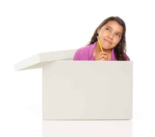 Attractive Young Ethnic Female with Pencil Popping Out and Thinking Outside The Box Isolated on a White Background. raise kids to be entrepreneurs is an out of the box idea.