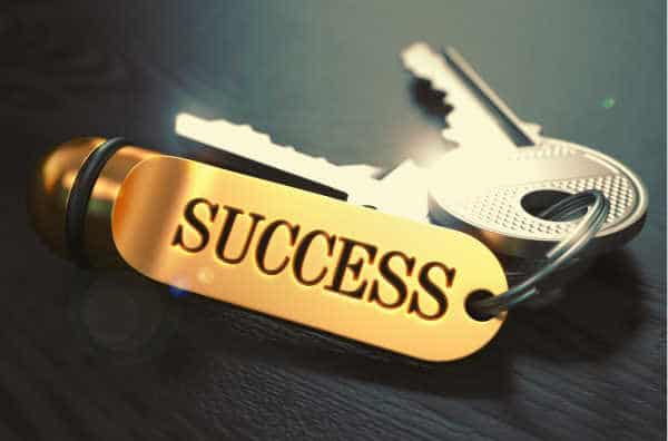 set of two keys and a keychain.  Keychain has success engraved in it. What symbolizes success?Entrepreneur vs Employee. What does success look like for Christians? raise kids to be entrepreneurs