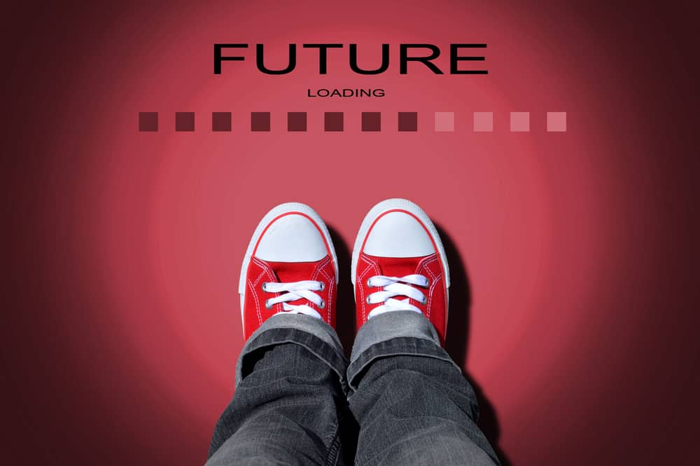 red shoes with message: future loading - creative red keds like an entreprenuer - entreprenuer vs employee mindset - raise kids to be entrepreneurs