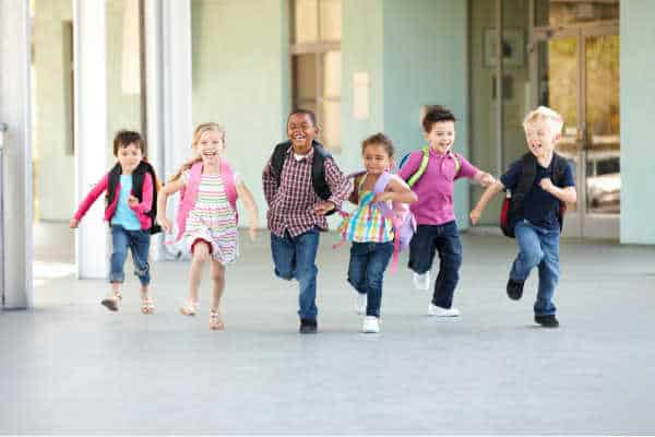 Children smiling and running from school because school is out - this is not that attitude you want when you prepare your homeschooler to be an entreprenuer