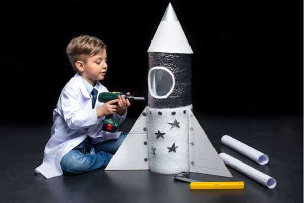Little boy engineering creating a rocket ship showing entreprenuerial spirit - prepare your homechooler to be an entreprenuer