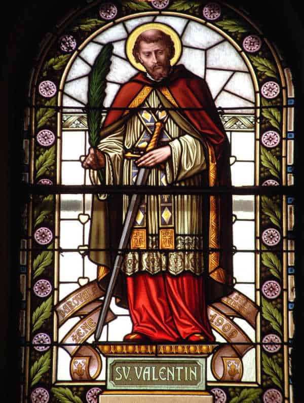 Stained glass window with image of St Valentine.  St Valentine is the real faith hero behind St Valentine's Day.