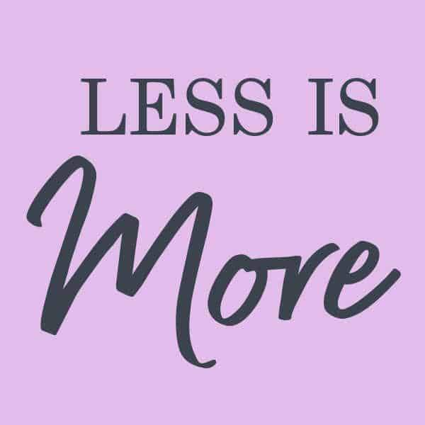 Purple square with the words less is more, a reminder for mom's to simplify your family life.