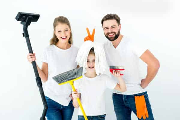 Mom, dad, and little girl - all cleaning the house so that there is no unappreciated mom.